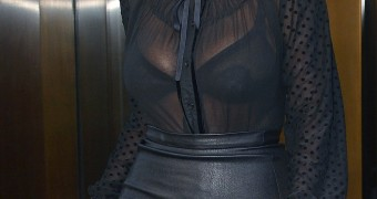 Kim Pregnant in Tight Leather Skirt