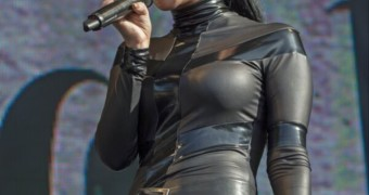 Tulisa Contostavlos Performing in a Rubber Catsuit