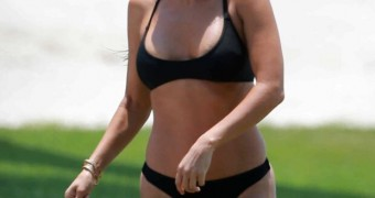 Kourtney Kardashian in a sexy black thong-bikini