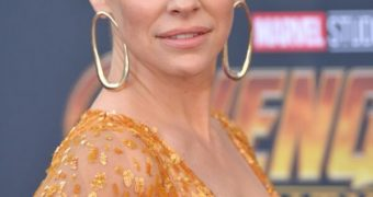 Evangeline Lilly braless cleavage @ Avengers Premiere