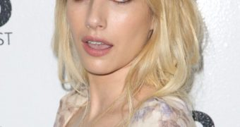 Emma Roberts shows cleavage for no limits abuse and degradation.