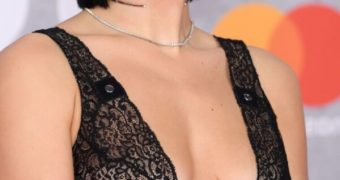 Dua Lipa- British Singer shows off Cleavage in See-Through dress