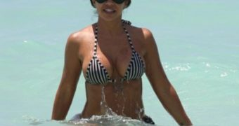 Vida Guerra in Bikini on the Beach in Miami