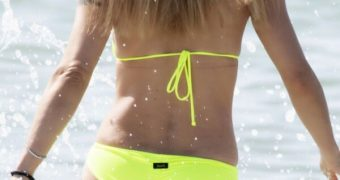 Michelle Hunziker in Sexy Yellow Bikini