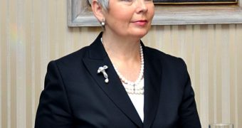 Mature politician with short gray hair (non-nude)