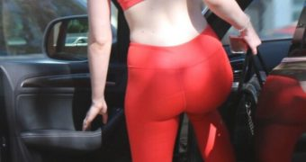 Elle Fanning in red gymwear