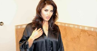 Sunny leone strips out of black bathrobe