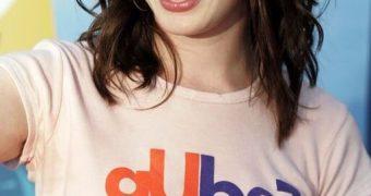 Anne Hathaway poking through her t-shirt